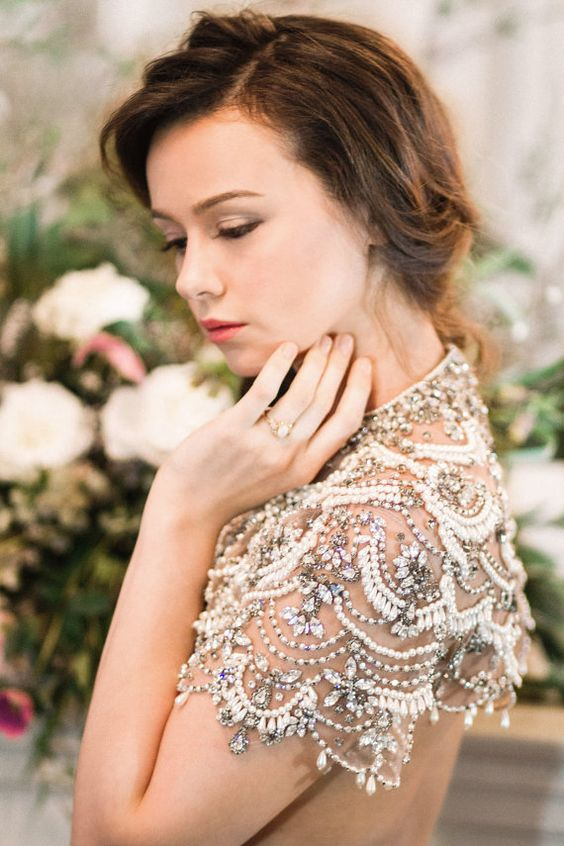 a heavily embellished rhinestone and pearl shoulder cover will make a bold accent in your look