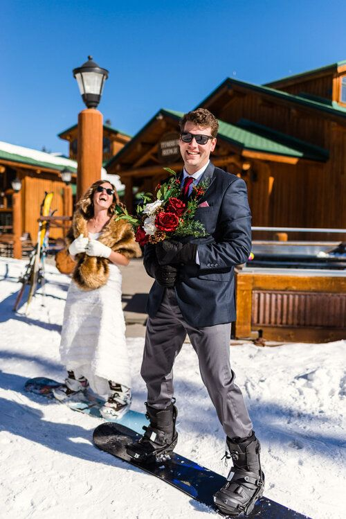 a just married couple going to snowboard together is a great idea for a bold snowboard-loving wedding