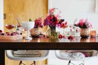 a lovely Valentine's Day engagement tablescape with lots of blooms, petals and delicious drinks and cupcakes