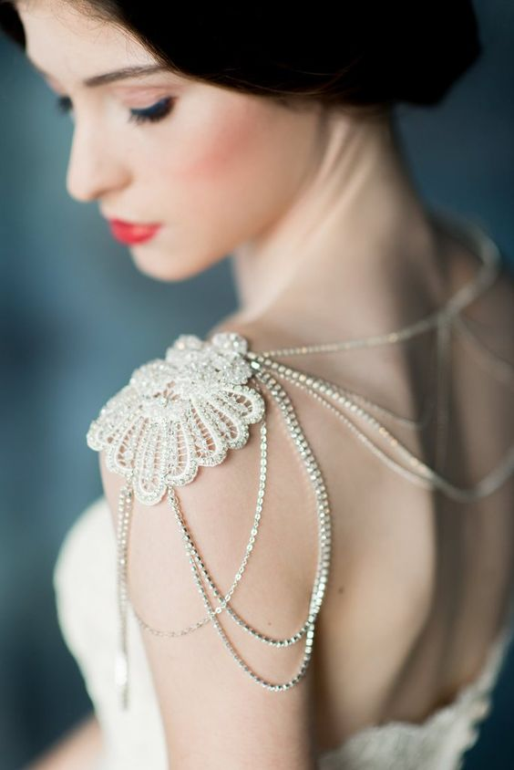 a refined crystal shoulder necklace with a gold lace touch is a chic piece to wear with your wedding dress