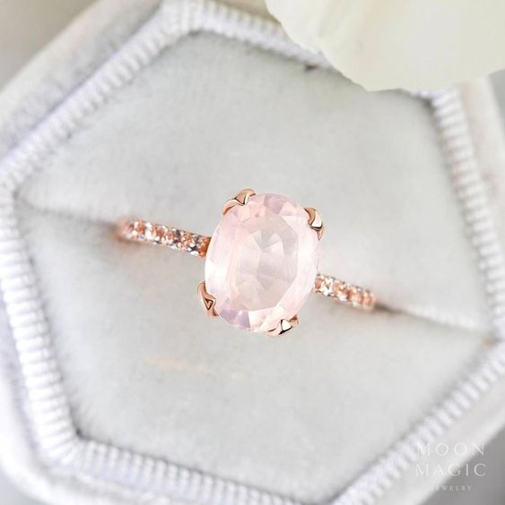 a rose gold and rose quartz oval ring is pure elegance and a very refined piece for a bride