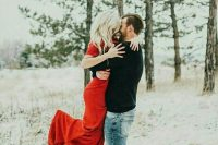 a snowy Valentine engagement with a red dress is a lovely idea to enjoy