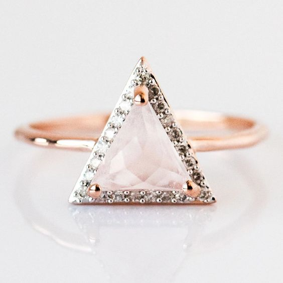 a stunning rose gold ring with a triangle-shaped rose quartz and diamonds is lovely and wow