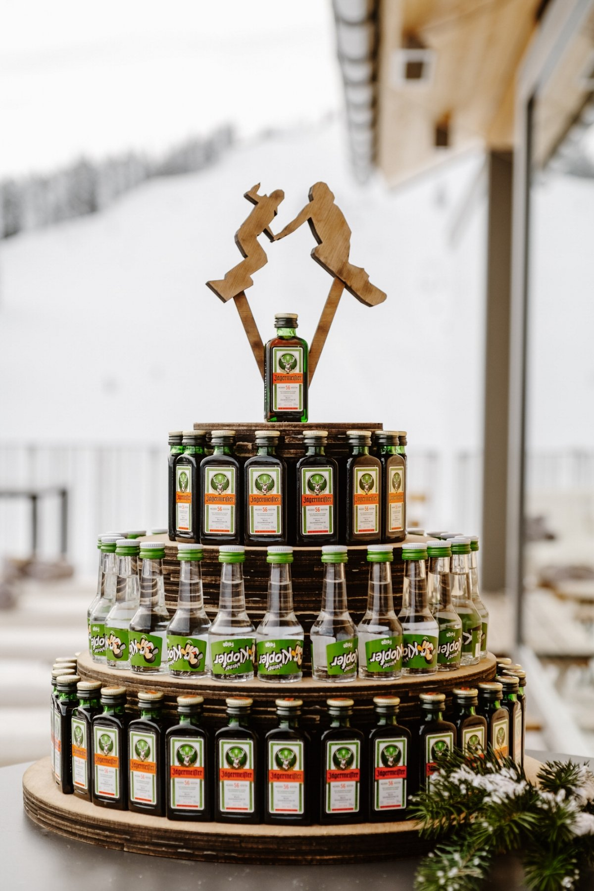 a wedding bar of bottles with wooden snowboard toppers is a gorgeous idea for a snowboarding wedding