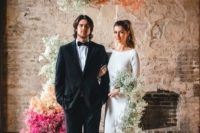 an industrial wedding ceremony sapce deccorated with colorful baby's breath looks unique and very bold