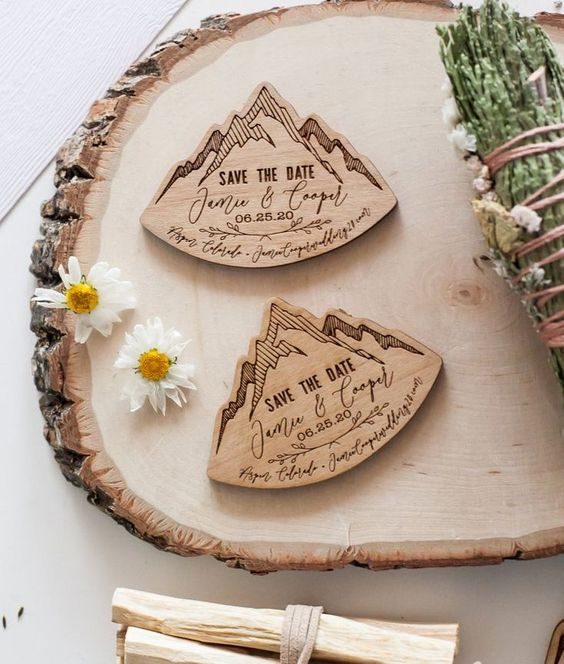 burnt wooden save the dates shaped as mountains are great for a ski resort or mountain wedding