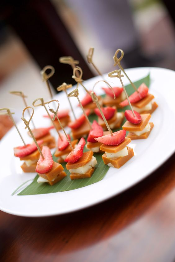 cheese and caramel sandwiches topped with strawberries and on skewers are adorable, delicious and very cool