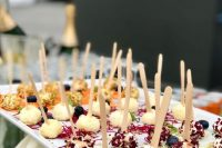 cheese balls with fresh herbs, nuts and veggies on skewers are simple and cool Valentine wedding appetizers to try
