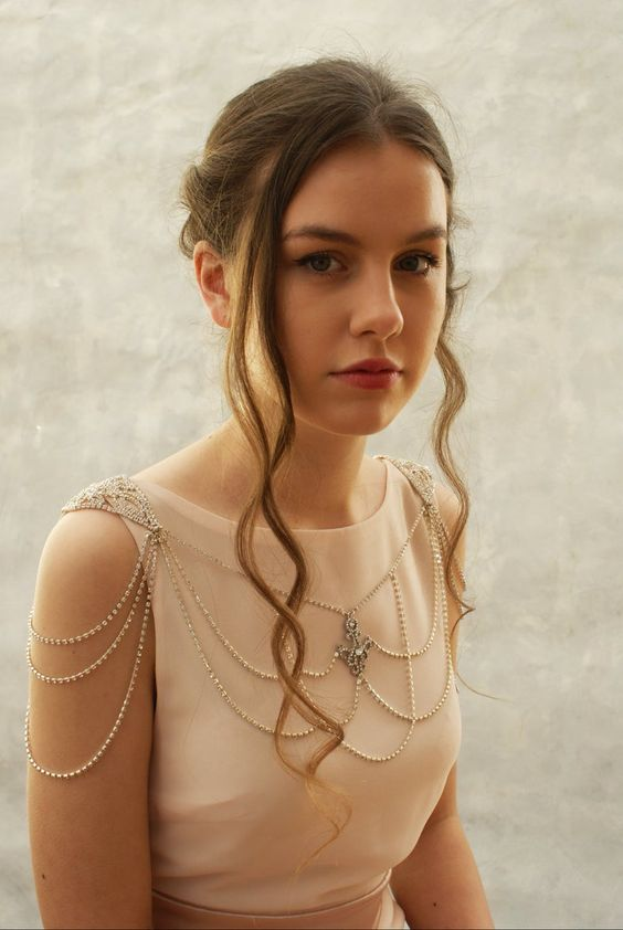 delicate gold and rhinestone shoulder jewelry with layered threads and a chic pendant in the center over a high neckline wedding dress
