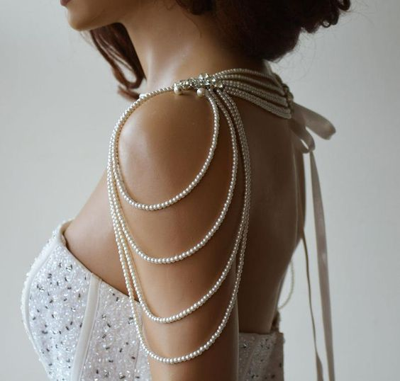 elegant pearl shoulder jewelry with rhinestones and pearl threads hanging down is very chic and elegant