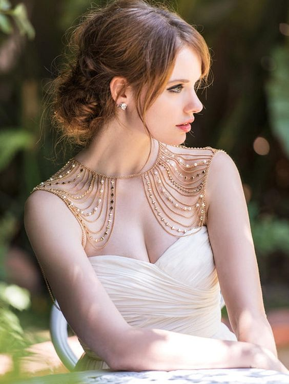 gorgeous gold and beads and pearls shoulder jewelry that echoes with the bridal hair and adds a warm feel
