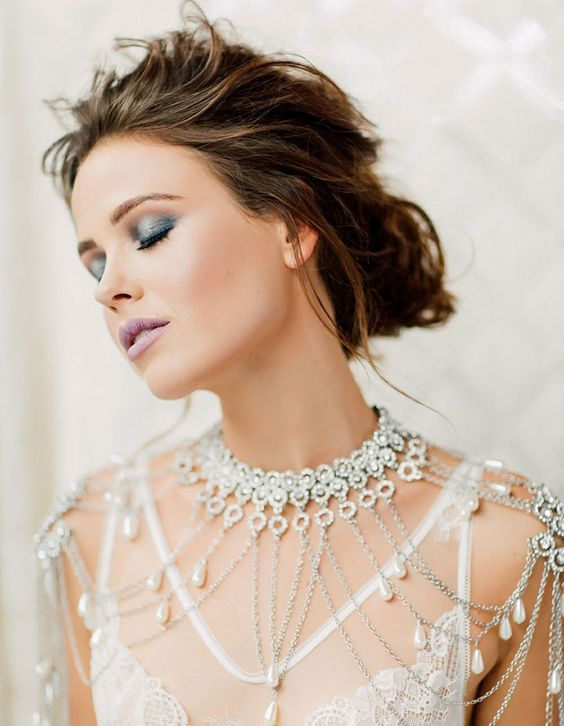luxurious rhinestone, silver chains and pearls shoulder jewelry is a refined and chic piece to rock at the wedding