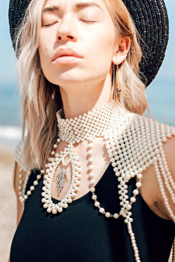 luxurous pearl shoulder jewelry with a collar and statement pendants for a bride who loves traditional but done fresh and new