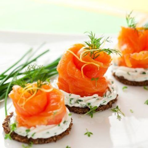 mini tarts with cream cheese and herbs and salmon on top are delicious Valentine appetizers to enjoy