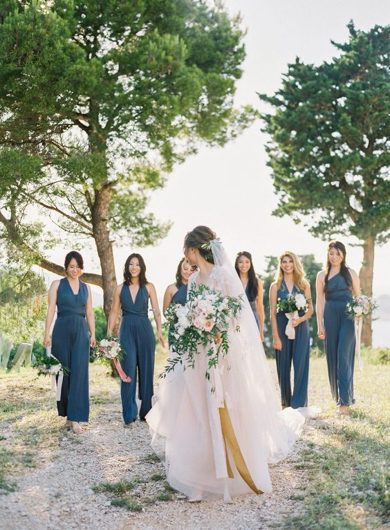 mismatching blue bridesmaid jumpsuits with various necklines to add color and chic to your bridal party