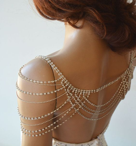 rhinestone threads as dramatic shoulder jewelry to add a shiny glam touch to the look