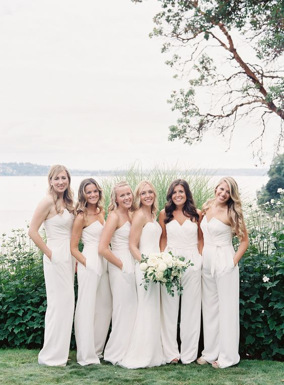 strapless white jumpsuits with a geometric neckline is a trendy and chic choice for a modern wedding