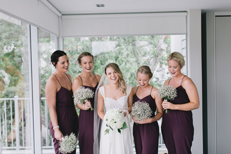 fitting purple spaghetti strap jumpsuits with draped bodices are great for a fall wedding