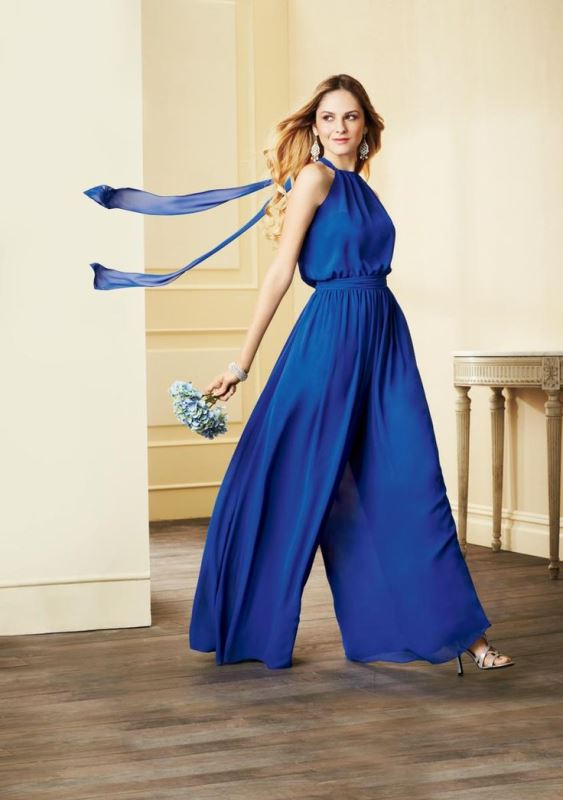 a bright blue halter neckline jumpsuit with a highlighted waist and wideleg pants plus long ties on the back
