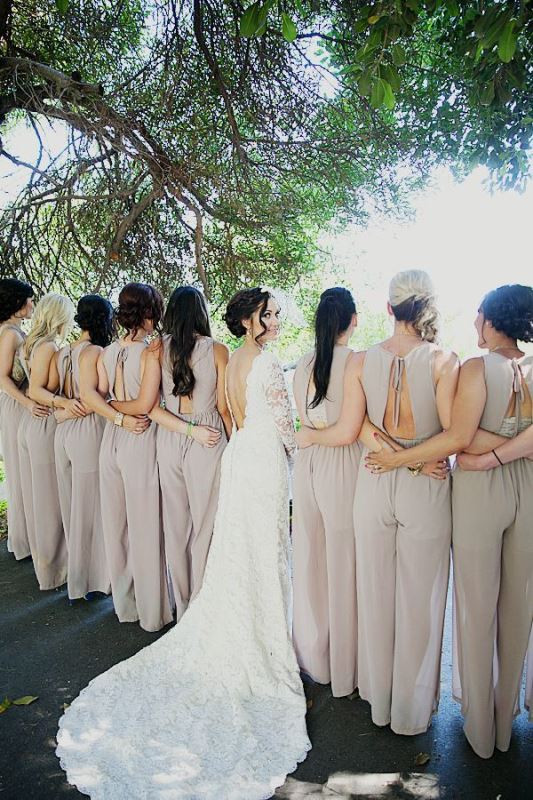 neutral fitting bridesmaid jumpsuits with high necklines and cutout backs with ties for a modern feel