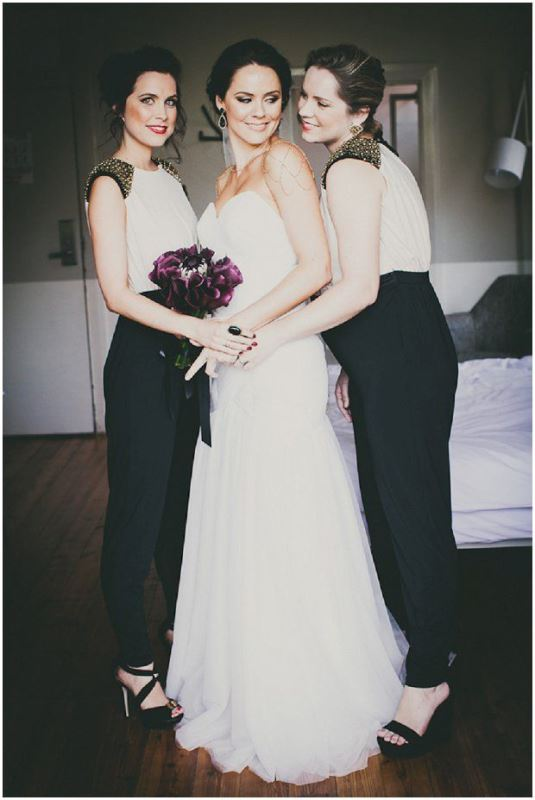 elegant black and white bridesmaid jumpsuits with studded shoulders, statement earrings and platform shoes