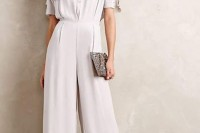 an off-white jumpsuit with a crochet top, short sleeves and wideleg pants plus platform shoes