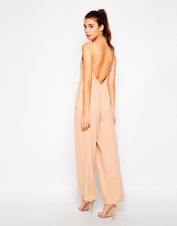 a blush jumpsuit with spaghetti straps, wideleg pants and a cutout back plus matching heels for a summer wedding