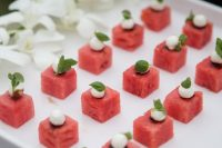 watermelon cubes with mozzarella cheese and fresh herbs are delicious and cool Valentine wedding appetizers