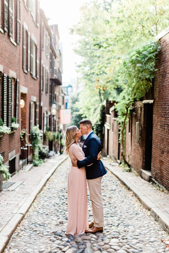 you may wear a blush maxi dress with a slight train and long sleeves to look romantic and chic