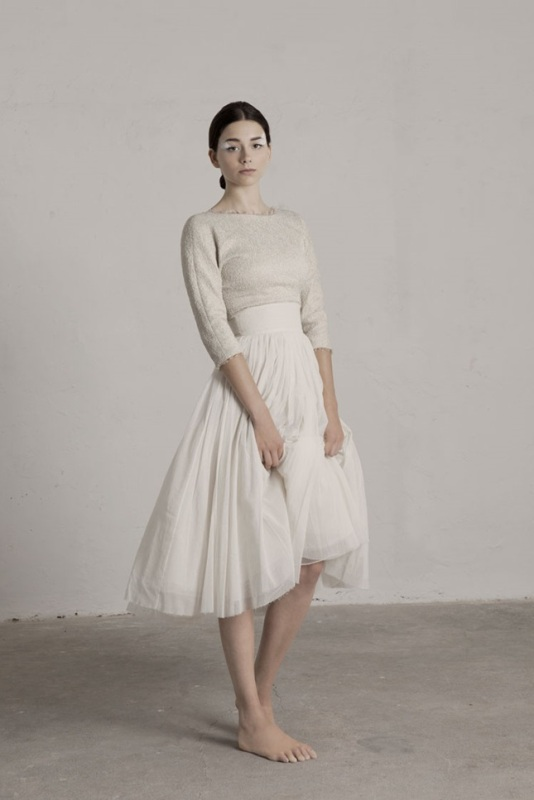 a simple ballerina look with a sparkly short sleeve bodice with a high neckline and a pleated high waisted midi skirt