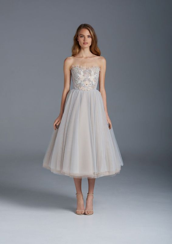 a light blue strapless A-line wedding dress with a full tulle skirt and floral embroidery for a romantic and chic look