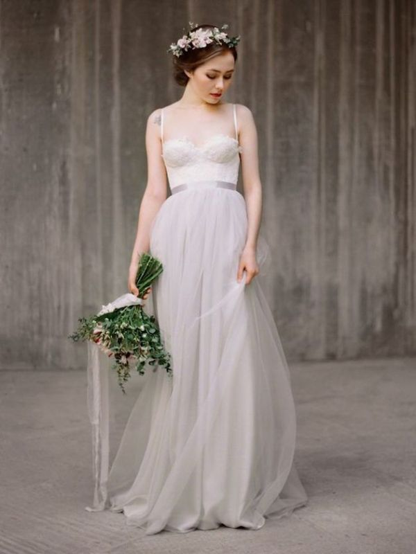 a romantic wedding separate with a white bustier top with spaghetti straps, a grey layered tulle skirt looks ethereal