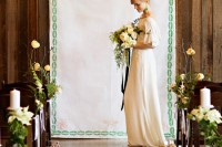 a cool embroidery wedding backdrop with botanical motifs, some whimsical arrangements decorating the aisle