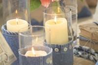 candles wrapped with denim and blooms with denim flowers in them for cool rustic and cowboy-themed decor