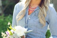 a bride covering up with a chambray shirt is a cool and bold idea, you may also try a denim jacket instead