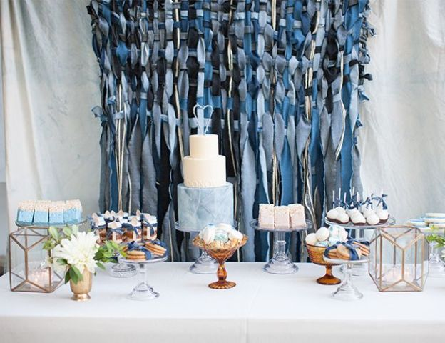 a contrasting woven denim backdrop, matching ribbons highlighting the desserts and blue desserts for a casual feel
