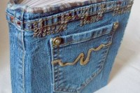 a guest book wrapped with blue denim and a pocket is a cool idea for a modern or casual edding