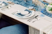 denim pillows and menues match a blue printed table runner and make the table relaxed boho and casual