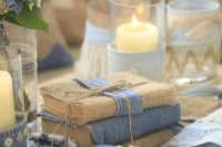 a denim ring pillow and some guest books wrapped with burlap and denim for a casual wedding