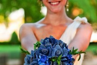 a blue wedding bouquet with bright blue blooms and those made of denim for a non-traditional look