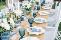 denim cutlery pockets, blue glasses, a blue runner is a cool idea for sprucing up the table