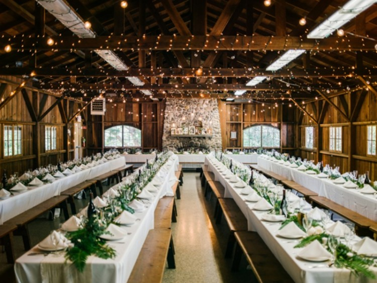greenery runners on the tables and lights over the tables make the space bright, fresh and welcoming