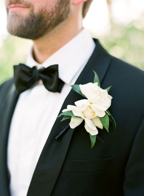 magnolia blooms make very cool boutonnieres for elegant groom's looks, they contrast black tuxedos