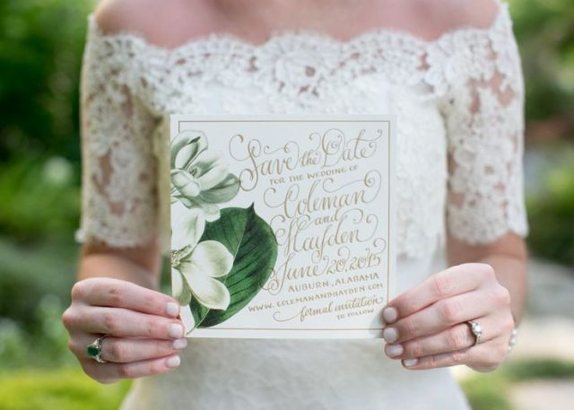 a cool save the date with gold calligraphy and magnolias is a perfect idea for a southern wedding