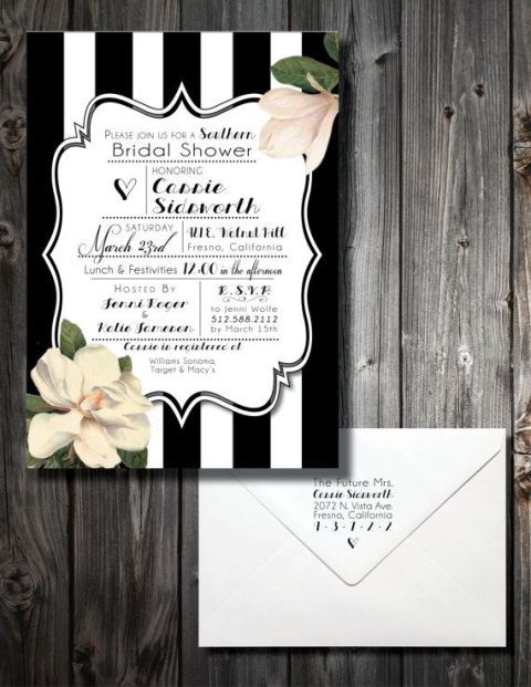 a wedding invitation suite with a white and black and white part with magnolias for an elegant and classic southern look