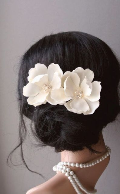 faux magnolia blooms with beads will accent your hairstyle in the best way possible