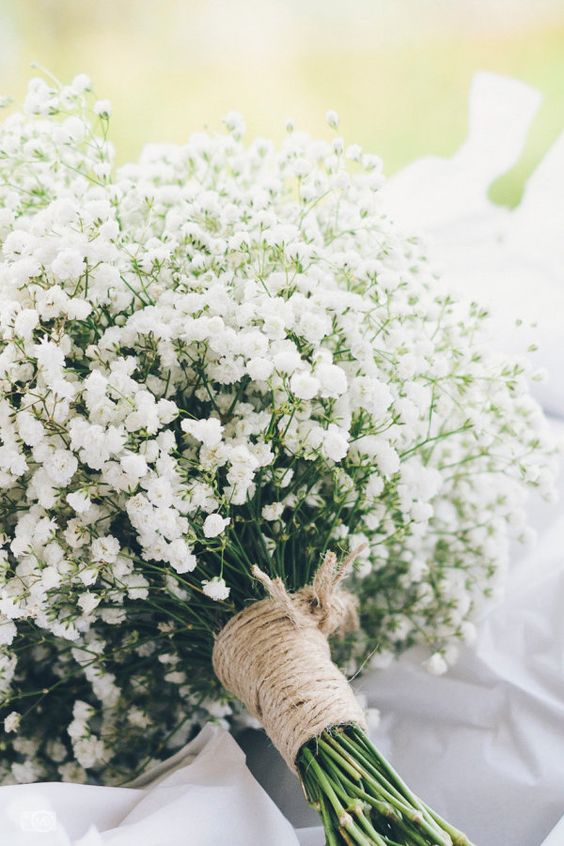a baby's breath wedding bouquet with a twine wrap is a stylish and chic idea for a rustic wedding and won't break the budget