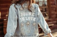 a bleached embellished and fringed bridal denim jacket with applique letters is a cool coverup for a boho bride