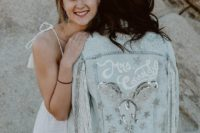 a bleached embellished fringe bridal jacket is a nice and chic coverup for a boho bride