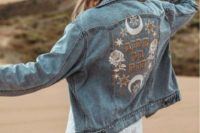 a bleached embroidered denim jacket and a hat make up a cool and chic boho look adding a free-spirited feel